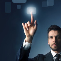 Businessman pointing to lighted button